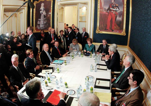 French Foreign Minister Laurent Fabius (3rd L), EU envoy Catherine Ashton (6th L), U.S. Secretary of State John Kerry (3rd R) and Britain's Foreign Secretary Philip Hammond (front L) sit a a table during talks in Vienna November 21, 2014