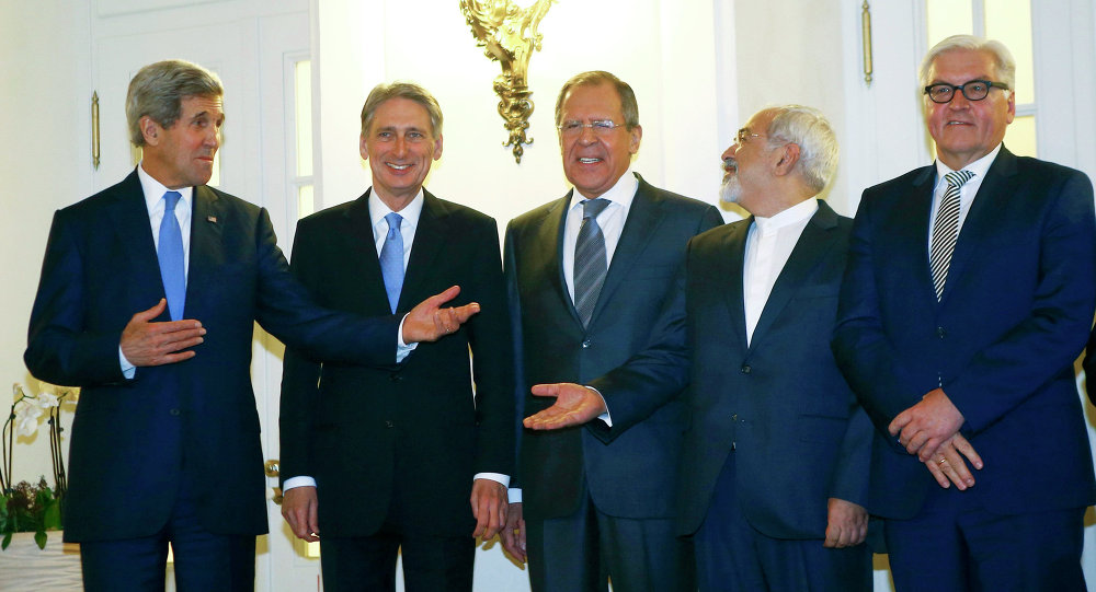 U.S. Secretary of State John Kerry, Britain's Foreign Secretary Philip Hammond, Russian Foreign Minister Sergei Lavrov, Iranian Foreign Minister Javad Zarif and German Foreign Minister Frank-Walter Steinmeier (L to R) pose for photographers before a meeting in Vienna
