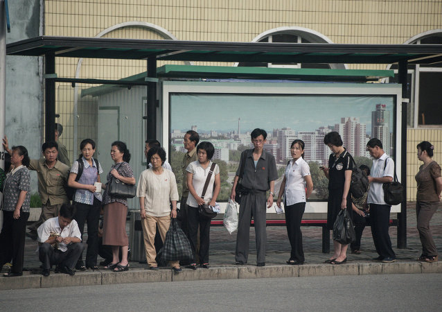 People at a bust stop in Pyongyang