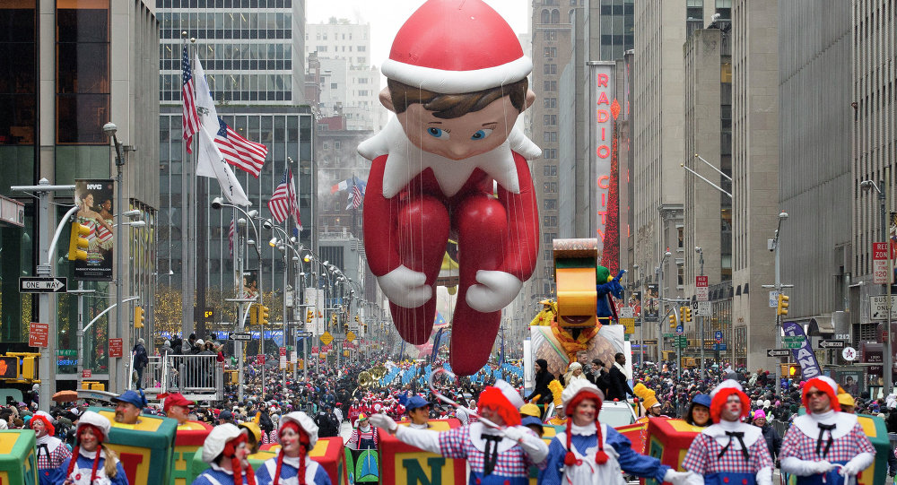 The Elf on the Shelf balloon is marched down Sixth Avenue during the Macy's Thanksgiving Day Parade, Thursday, Nov. 27, 2014, in New York