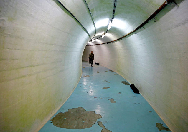 A member of the Armed Forces of Bosnia and Herzegovina walks through a tunnel in Josip Broz Tito's underground secret bunker (ARK) in Konjic