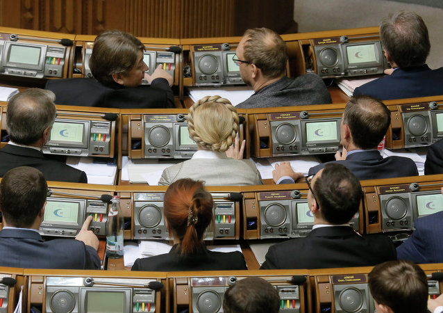 Former Prime Minister and leader of the Fatherland party Yulia Tymoshenko, center, and lawmakers from her party vote during a parliament session in Kiev, Ukraine, Tuesday, Dec. 2, 2014