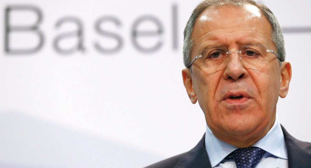 Russia's Foreign Minister Sergei Lavrov speaks to media in a news conference during a meeting of foreign ministers from the Organization for Security and Cooperation in Europe (OSCE) in Basel December 5, 2014
