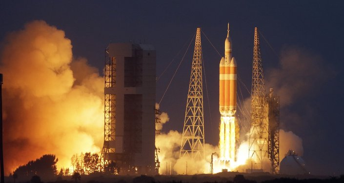 NASA's Orion spacecraft, atop a United Launch Alliance Delta 4-Heavy rocket, lifts off on its first unmanned orbital test flight from the Cape Canaveral Air Force Station Friday, Dec. 5, 2014