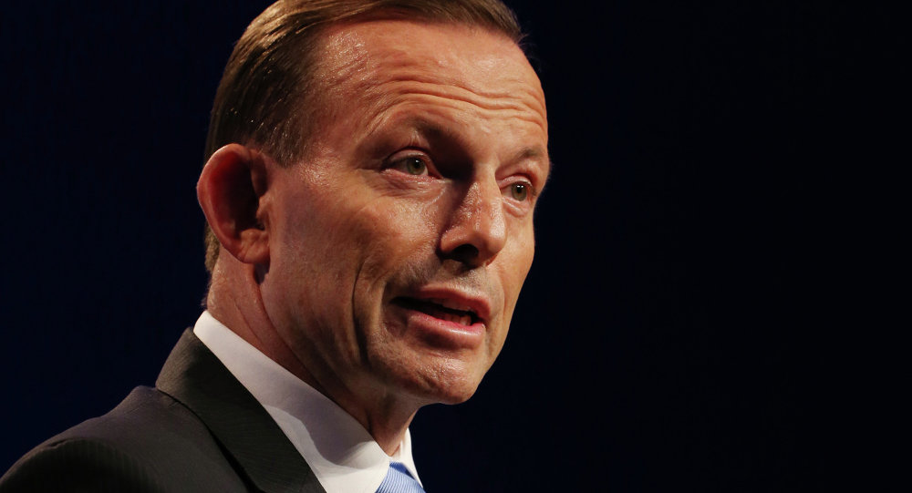 Australia's Prime Minister Tony Abbott speaks to the media during a press conference at the conclusion of the G-20 summit in Brisbane, Australia, Sunday, Nov. 16, 2014