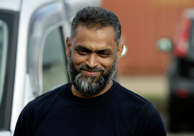 British Moazzam Begg leaves Belmarsh Prison in south London, after his release, Wednesday, Oct. 1, 2014