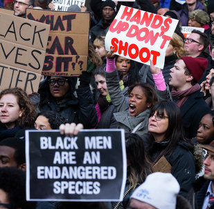 Demonstrators march in New York, Saturday, Dec. 13, 2014, during the Justice for All rally and march