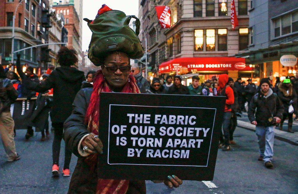 A woman takes part in a march against police violence, in Midtown Manhattan, New York December 13, 2014