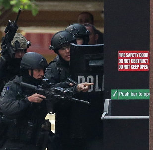 Armed police are seen outside the Lindt Cafe