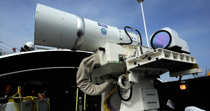 The Laser Weapon System (LaWS) temporarily installed aboard the guided-missile destroyer USS Dewey (DDG 105) in San Diego