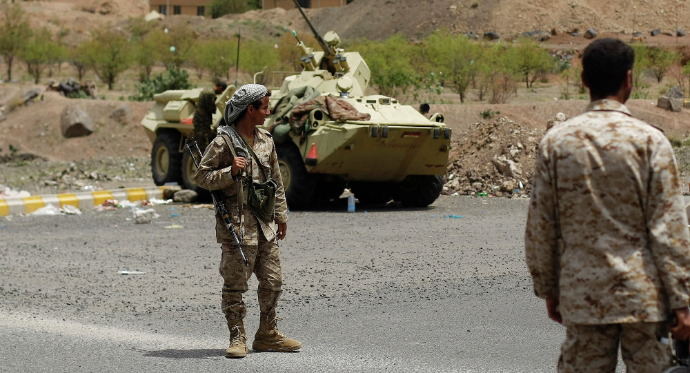 Yemeni army soldiers stand guard at a checkpoint in the entrance of Sanaa, Yemen