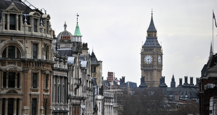 Whitehall and the clock tower of the Westminster Palace with the Big Ben bell as seen from Trafalgar Square
