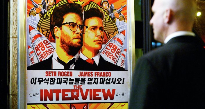 A security guard stands at the entrance of United Artists theater during the premiere of the film The Interview in Los Angeles, California in this December 11, 2014 file photo.