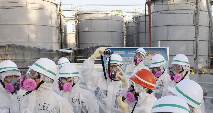 Members of a South Korean investigation team inspect the Fukushima Daiichi nuclear power plant in Okuma, Fukushima Prefecture, on Dec. 17, 2014