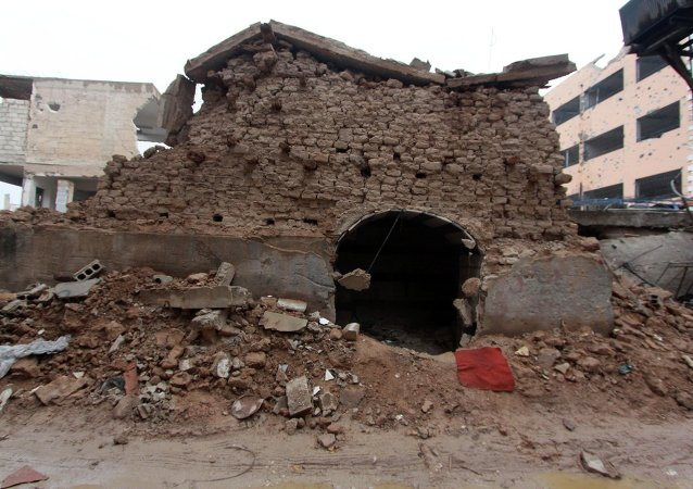 A damaged synagogue is seen in the Damascus suburb of Jobar