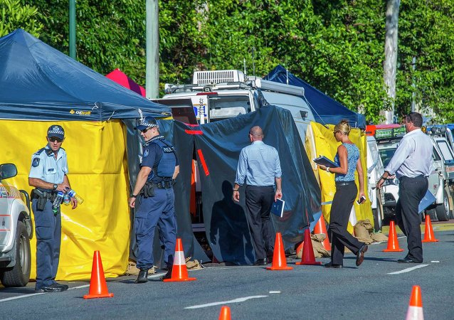 Detectives work at the scene of a stabbing attack at a home in Cairns, northern Queensland, December 19, 2014
