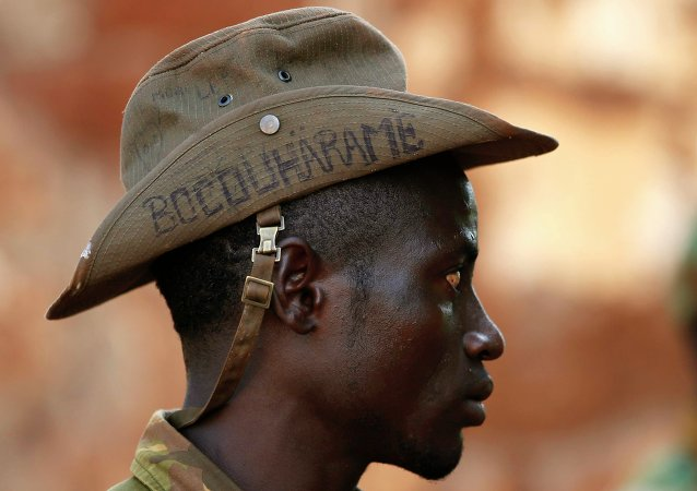 PICTURES OF THE YEAR 2014 A Seleka fighter wears a hat that reads Bocou Harame, in a reference to the Islamist militant group Boko Haram, in the town of Bria, in this April 9, 2014 file photo