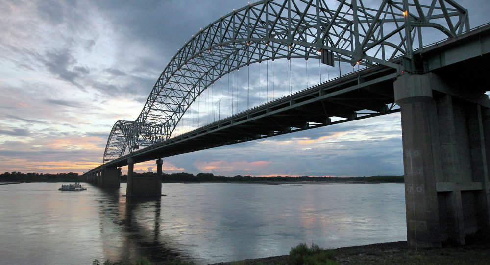 In this July 13, 2012, photo, the Memphis Queen riverboat uses the deep center of the Mississippi River to go under the I-40 bridge while heading upriver, in Memphis, Tenn