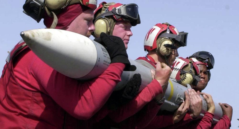 Aviation Ordnancemen lift an Advanced, Medium-Range, Air-to-Air Missile (AMRAAM)