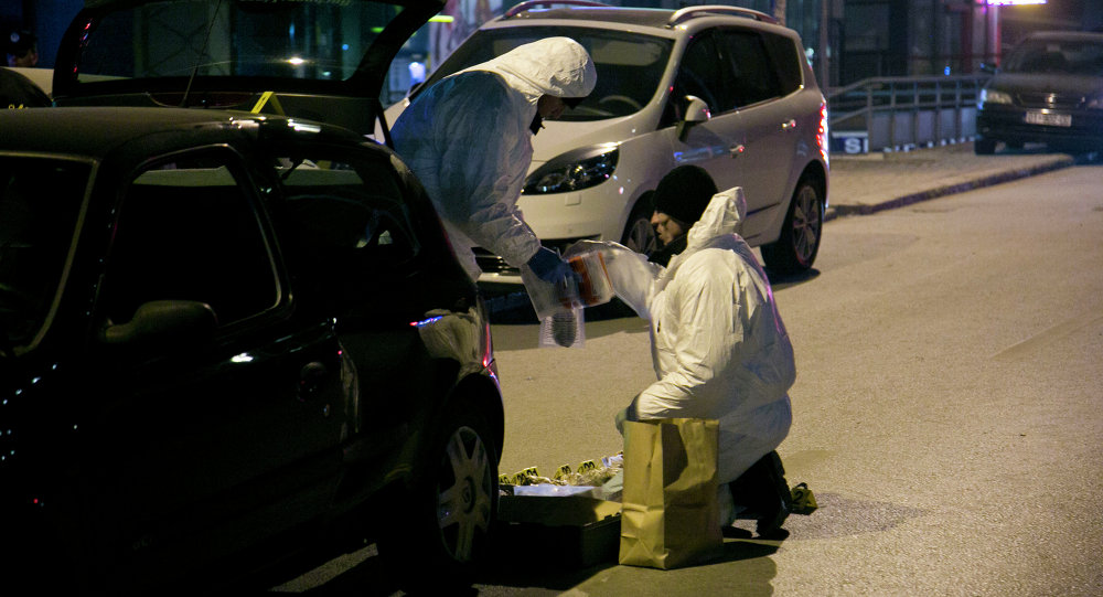 Kosovo police forensic unit members collect the material found in a car after claiming they have foiled an apparent attempt to detonate a car filled with explosive material in the capital Pristina.