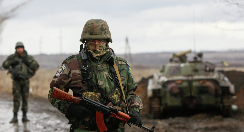 A Ukrainian serviceman guards at a checkpoint near the eastern Ukrainian town of Debaltseve in Donetsk region.