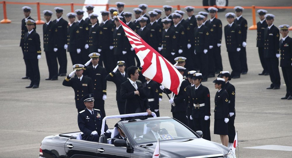 Japanese Prime Minister Shinzo Abe reviews members of the Japan Self-Defense Force during the annual Self-Defense Forces Commencement of Air Review at Hyakuri Air Base, north of Tokyo.