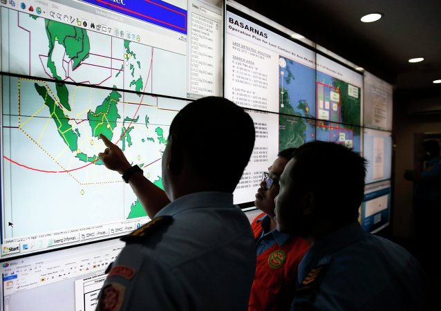 Military and rescue authorities monitor progress in the search for AirAsia Flight QZ8501 in the Mission Control Center inside the National Search and Rescue Agency in Jakarta December 29, 2014