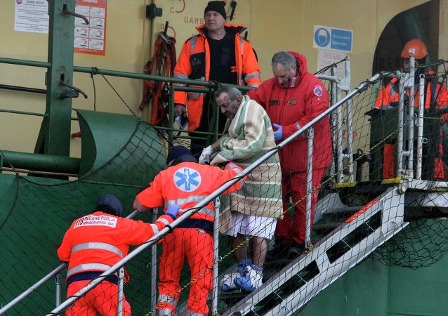 A wounded passenger is helped as he leaves from the  Spirit of Piraeus  cargo container ship after the car ferry Norman Atlantic caught fire in waters off Greece December 29, 2014