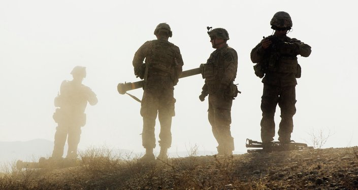 U.S. soldiers from D Troop of the 3rd Cavalry Regiment walk on a hill after finishing with a training exercise near forward operating base Gamberi in the Laghman province of Afghanistan December 30, 2014