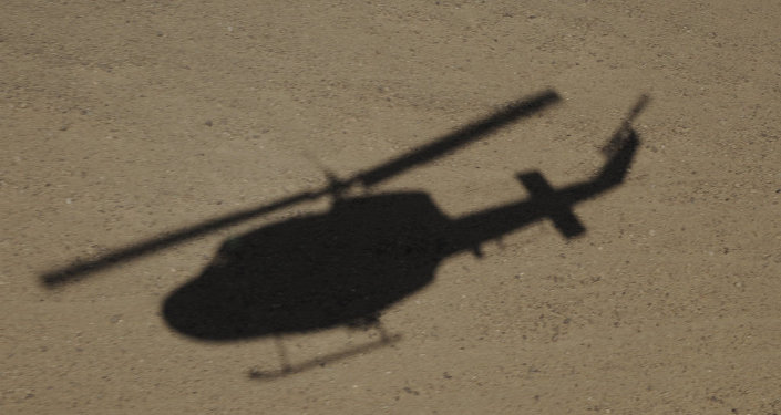 Afghanistan-The shadow of an Italian Air Force AB-212 helicopter