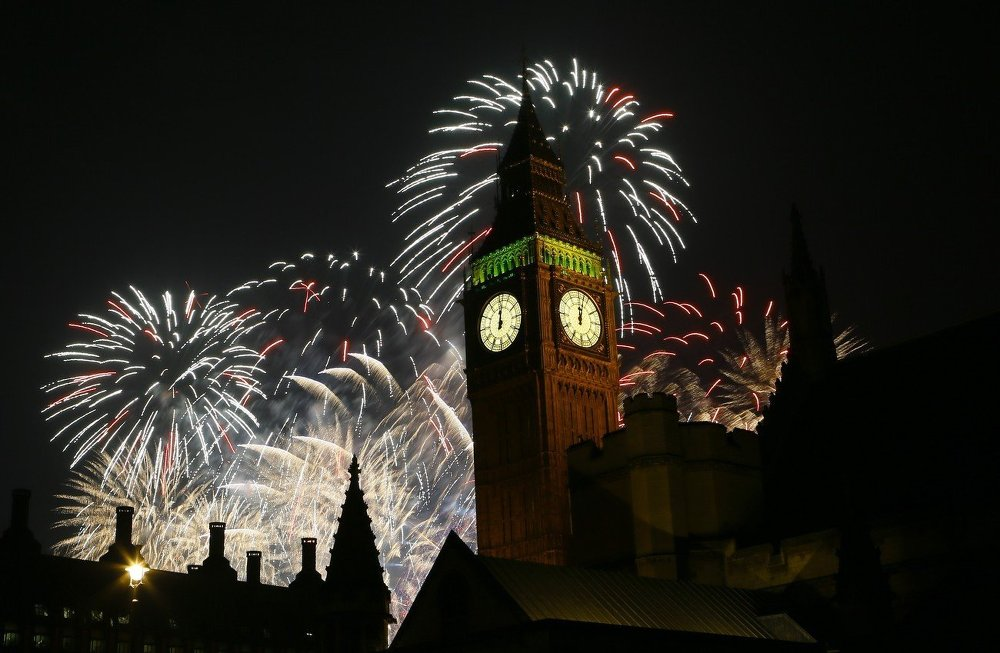 Fireworks explode over the clock known as 'Big Ben' housed in Elizabeth Tower, to celebrate the New Year in London, Thursday, Jan. 1, 2015