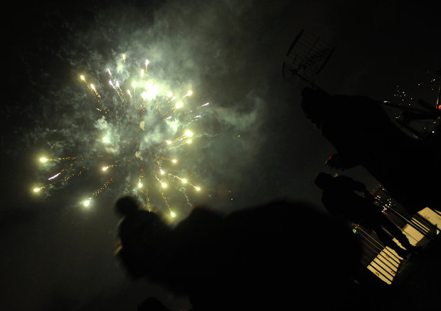 Fireworks erupt over the Naples skyline in southern Italy on January 1, 2015 to mark New Year's celebrations