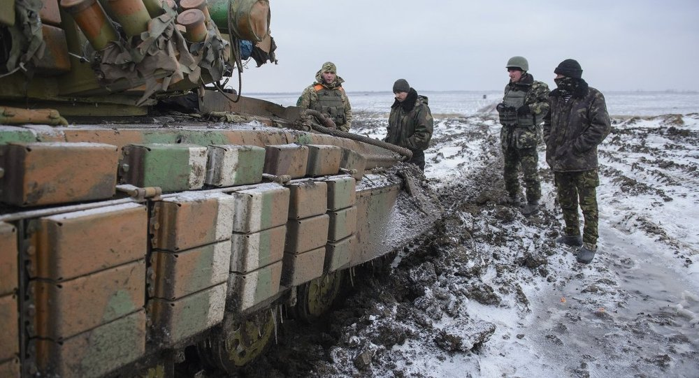 Ukrainian soldiers and a tank at a battle position in the Donetsk Region.