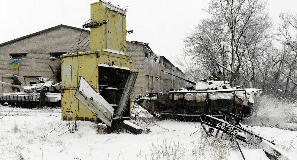 A Ukrainian Army tank and APC hold a position
