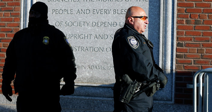 Police officers stand outside the federal courthouse in Boston for the first day of jury selection in the trial of Boston Marathon bombing suspect Dzhokhar Tsarnaev