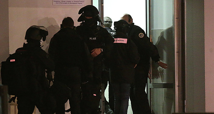 Police are seen during an operation in the Croix-Rouge suburb of Reims, northern France early January 8, 2015