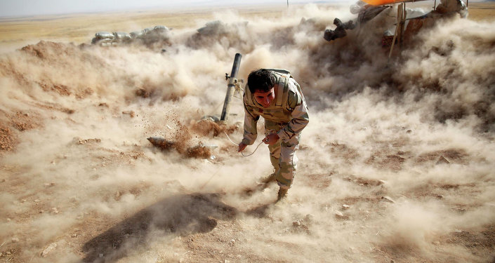 A Kurdish Peshmerga fighter launches mortar shells towards Zummar, controlled by Islamic State (IS), near Mosul in this September 15, 2014 file photo