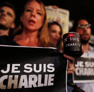 People participate in a vigil to pay tribute to the victims of a shooting, by gunmen at the offices of weekly satirical magazine Charlie Hebdo in Paris, at Paulista avenue in Sao Paulo, January 7, 2015