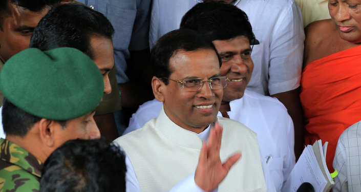 Sri Lanka's newly elected President Maithripala Sirisena waves as he leaves the Department of Election office after the election commissioner officially declared him as the new President on January 9, 2015 in Colombo, Sri Lanka.