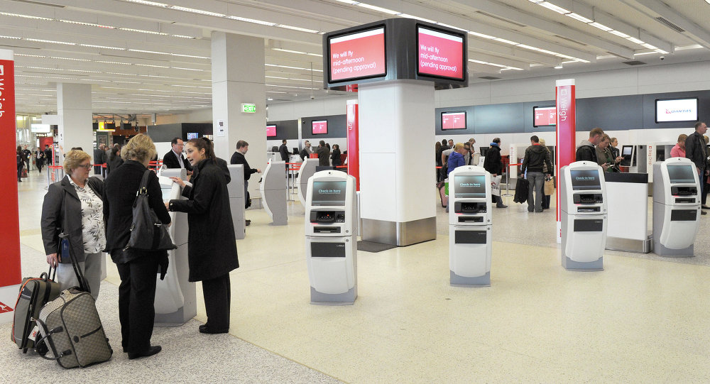 Passengers check in at Melbourne airport