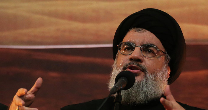 Hezbollah leader Sheik Hassan Nasrallah addresses supporters ahead of the Shiite Ashura commemorations, in the southern suburb of Beirut, Monday, Nov. 3, 2014.