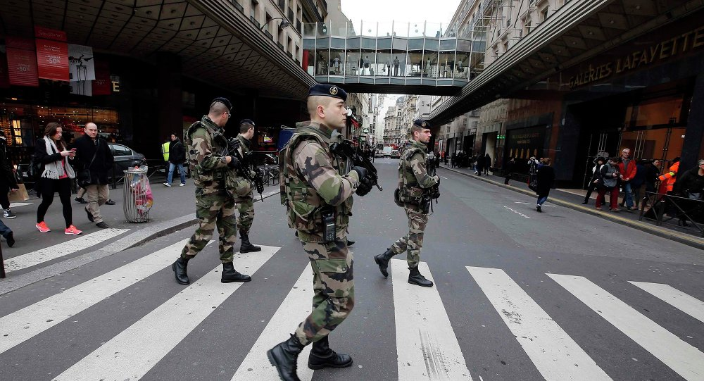 French soldiers patrol in the street near a department store in Paris as part of the highest level of Vigipirate security plan in Paris January 10, 2015.