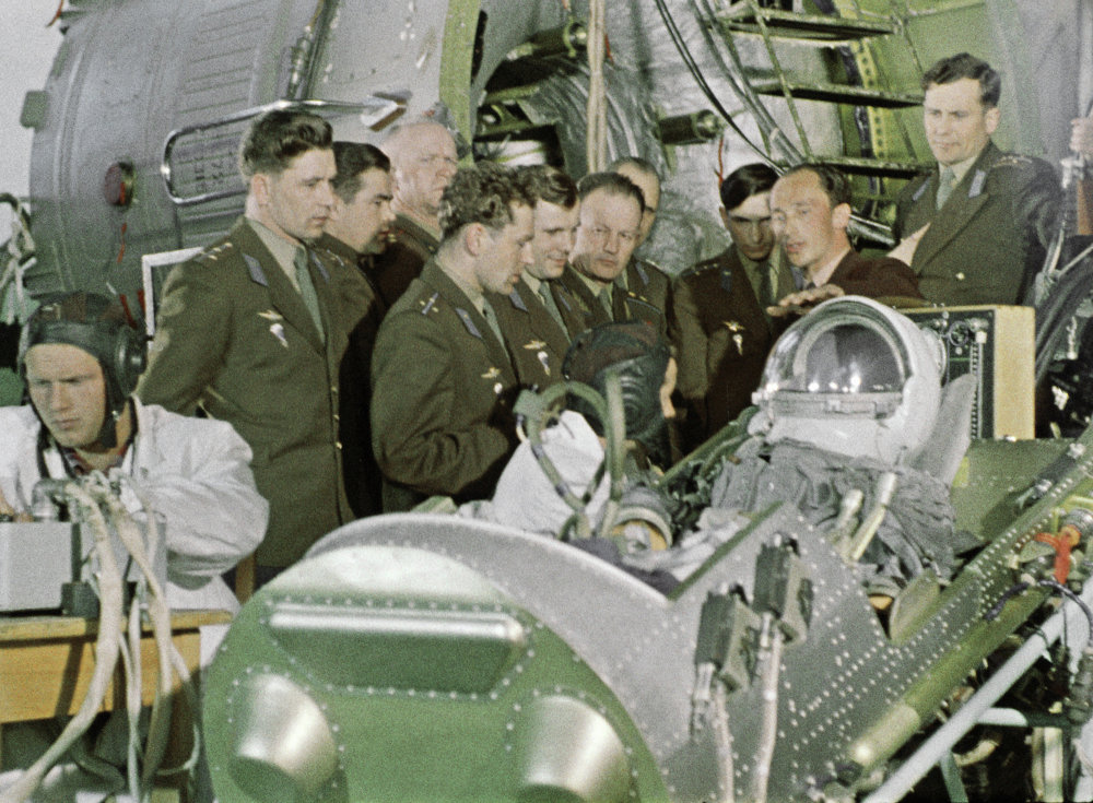 Cosmonaut training group members study space equipment