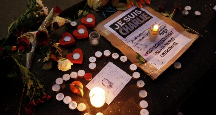 Candles form a heart, near a placard with the message, I am Charlie as people continue to pay tribute to the shooting victims on Wednesday at the satirical weekly Charlie Hebdo, at the Republique square in Paris