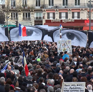 Parisians Carrying Charlie Hebdo Cartoons March Against Terrorism