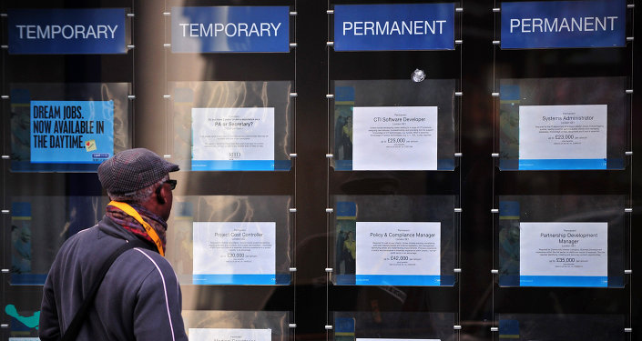 A man looks at job adverts in the window of a job recruitment centre in central London, on January 22, 2014