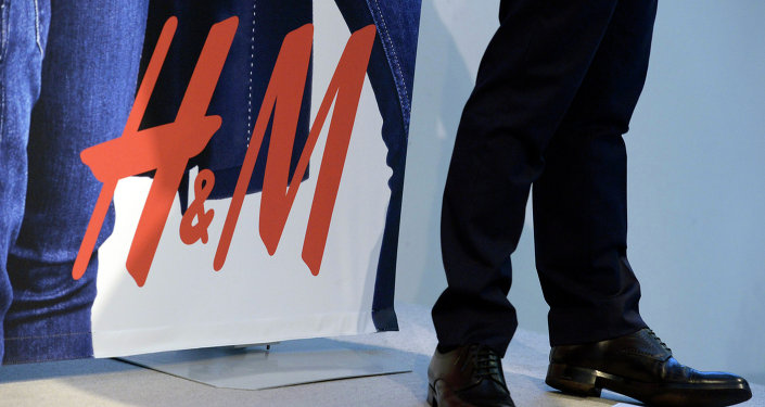 The logo of Swedish fashion retailer Hennes and Mauritz (H&M) is seen during a presentation of the company's interim report for the third quarter during a news conference in Stockholm on September 25, 2014
