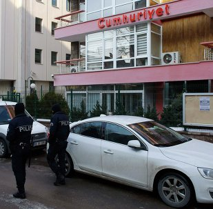 Riot police officers stand guard outside of the offices of daily newspaper Cumhuriyet in Ankara January 14, 2015