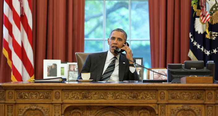President Barack Obama talks with President Hassan Rouhani of Iran during a phone call in the Oval Office, September 27, 2013