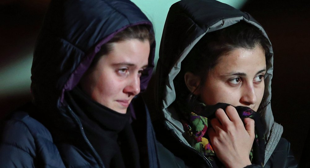Greta Ramelli (L) and Vanessa Marzullo, two Italian aid workers taken hostage in Syria five months ago, arrive at Ciampino airport in Rome January 16, 2015